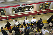 overhead view of commuters while waiting for the train to open the doors