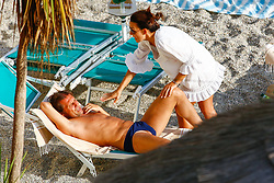 EXCLUSIVE: *NO WEB UNTIL 4PM BST 4TH SEPT* Chelsea head coach Antonio Conte and his wife Elisabeta Muscarello share a kiss in the ocean while on vacation in Italy. He is also seen reading Football English: Soccer Vocabulary for Learners of English book. Conte missed out on big playersin the transfer window. 01 Sep 2017 Pictured: Antonio Conte and Elisabetta Muscarello. Photo credit: Ferraro Simone / MEGA TheMegaAgency.com +1 888 505 6342