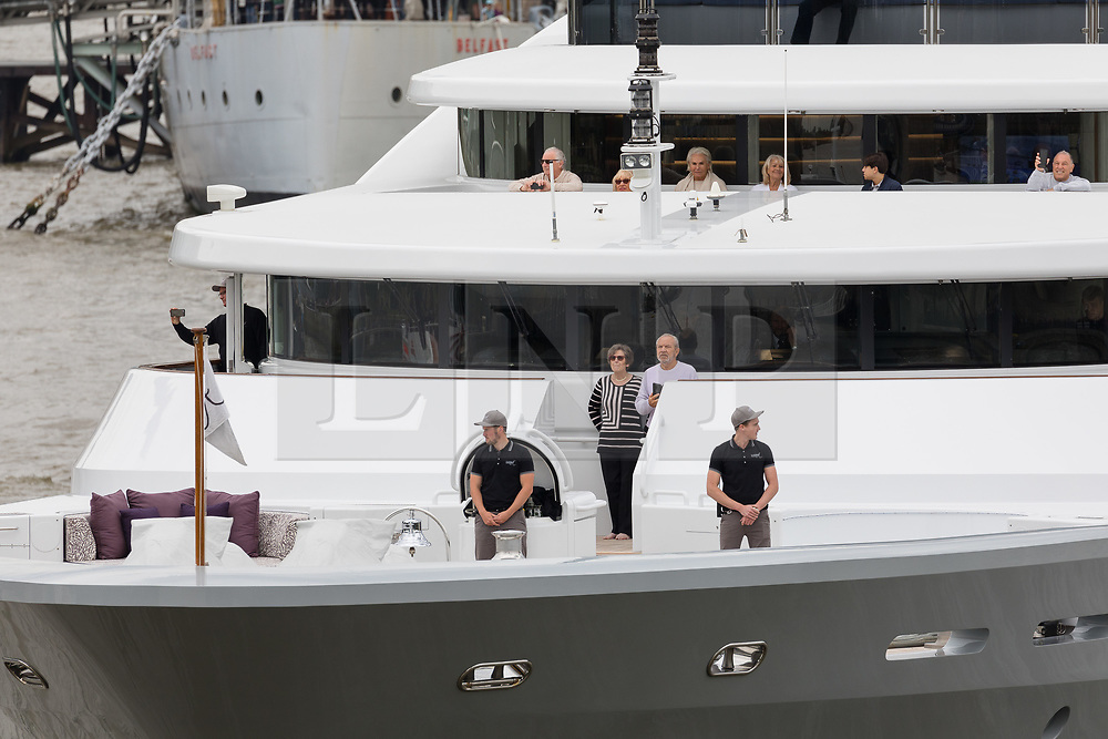 © Licensed to London News Pictures. 13/05/2018. London, UK. Alan Sugar takes photographs as he sails his luxury superyacht, Lady A on the River Thames this afternoon after it passed under Tower Bridge and parades in the Upper Pool in central London, before passing under Tower Bridge again and travelling east along the river. Alan Sugar reportedly purchased the 181 feet long yacht in 2015 and renamed her Lady A after his wife, Ann and it includes a jacuzzi and can sleep up to 12 guests. Lady A is reportedly still up for sale at around £13m after being put on the market last year, or it can be chartered with prices starting from around £12,500 per week. . Photo credit: Vickie Flores/LNP