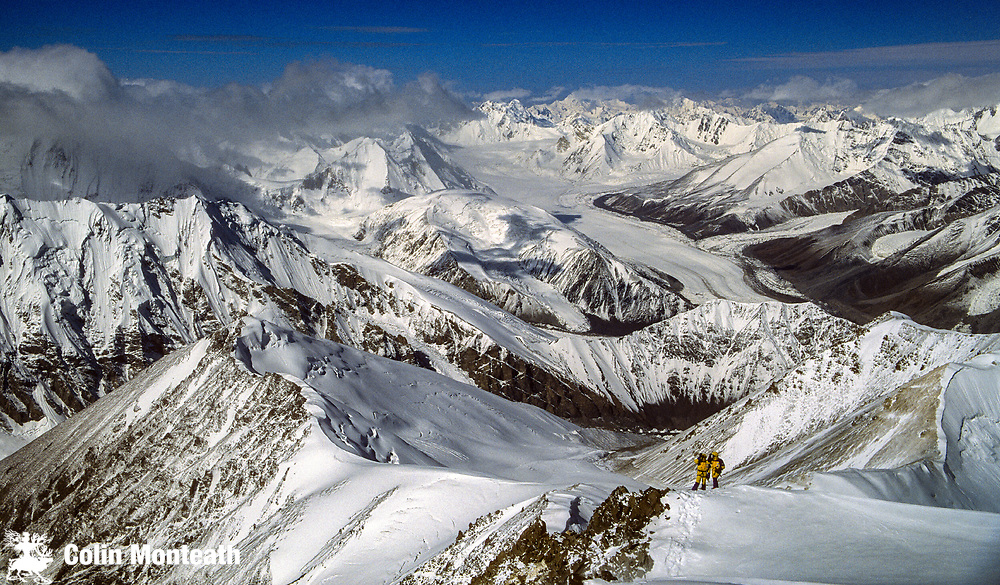 Looking down on climbers on Chongtar during 1st ascent, 1994, Sarpo Laggo glacier behind, Karakoram mountains, far western China, Central Asia