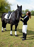Television presenter Kimberleigh Gelber horse riding in Richmond Park, London