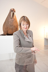 """© London News Pictures. 25/6/2013. Margate, Kent. Harriet Harman MP stands in front of the Horniman Museum walrus. Today Harriet Harman MP, Labour's Deputy Leader and Shadow Secretary of State for Culture, Media and Sport, visits Margate where she was given a tour of Turner Contemporary before meeting staff and local businesses in the """"Curious Margate"""" project. Picture credit Manu Palomeque/LNP"""