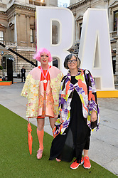 GRAYSON PERRY and his wife PHILLIPPA at the annual Royal Academy of Art Summer Party held at Burlington House, Piccadilly, London on 4th June 2014.