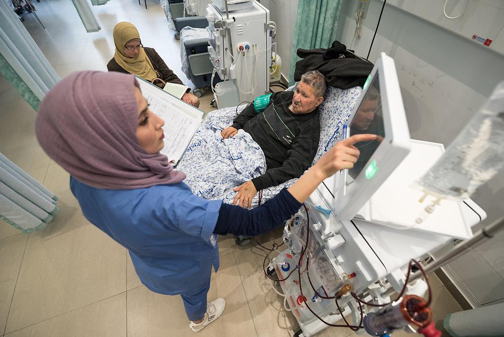 24 February 2020, Jerusalem: Nurse Hiba Almu'ti tends to Awni Idhadik, as he receives Dialysis treatment at the Augusta Victoria Hospital in Jerusalem.