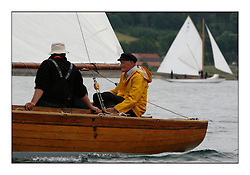 Hatasoo  with the McGrouthers Brother's sailing their 1894 Gunter Sloop...The Round the Cumbraes race to open the regatta. Light variable breeze and grey skies shrouded the fleet with a strong spectator fleet...* The Fife Yachts are one of the world's most prestigious group of Classic .yachts and this will be the third private regatta following the success of the 98, .and 03 events.  .A pilgrimage to their birthplace of these historic yachts, the 'Stradivarius' of .sail, from Scotland's pre-eminent yacht designer and builder, William Fife III, .on the Clyde 20th -27th June.   . ..More information is available on the website: www.fiferegatta.com . .Press office contact: 01475 689100         Lynda Melvin or Paul Jeffes