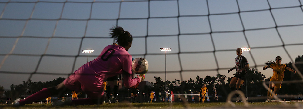 CSUN goalkeeper Jenna Koziol (00) dives for the ball in the Big West Semi-final against Long Beach State at Long Beach State on November 3, 2016.