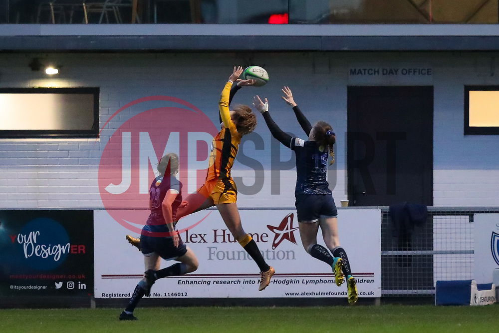 Lauren Delany of Sale Sharks Women leaps to catch a cross field kick from Katy Daley-McLean of Sale Sharks Women to score a try - Mandatory by-line: Nick Browning/JMP - 12/12/2020 - RUGBY - CorpAcq Stadium  - Sale, England - Sale Sharks Women v Wasps FC Ladies - Allianz Premier 15s