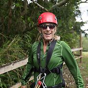 A woman prepares to zip line on the island of Kauai. Model released.