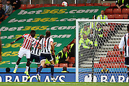 Mame Biram Diouf of Stoke City heads over the bar. Barclays Premier League match, Stoke city v West Bromwich Albion at the Britannia stadium in Stoke on Trent, Staffs on Saturday 29th August 2015.<br /> pic by Chris Stading, Andrew Orchard sports photography.