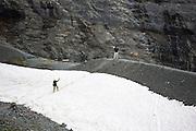 Hikers on the Eiger Trail by the Eiger Glacier, Eigergletscher, in Swiss Alps, Bernese Oberland, Switzerland