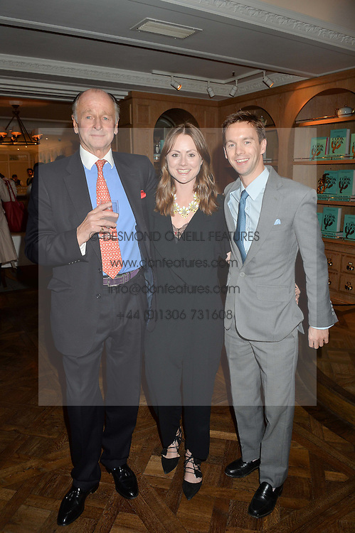 SIMON PARKER BOWLES with his son & daughter in law SAM & LOUISA PARKER BOWLES at a party hosted by Ewan Venters CEO of Fortnum & Mason to celebrate the launch of The Cook Book by Tom Parker Bowles held at Fortnum & Mason, 181 Piccadilly, London on 18th October 2016.