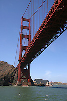 The Golden Gate Bridge is a suspension bridge spanning the Golden Gate - the opening of the San Francisco Bay onto the Pacific Ocean. Its name has nothing to do with its color, chosen by the Navy, but refers to the span of water. As part of both U.S. Route 101 and State Route 1, it connects the city of San Francisco on the northern tip of the San Francisco Peninsula to Marin County. The Golden Gate Bridge was the longest suspension bridge span in the world when it was completed during the year 1937 and has become an internationally recognized symbol of San Francisco.