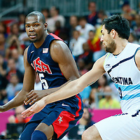 06 August 2012: USA Kevin Durant drives past Argentina Carlos Delfino during 126-97 Team USA victory over Team Argentina, during the men's basketball preliminary, at the Basketball Arena, in London, Great Britain.