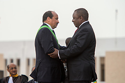 Aug. 2, 2014 - Nouakchott, Nouakchott, Mauritania - Deputy President of South Africa CYRIL RAMAPHOSA (right) congratulates president ABDEL AZIZ as he sworn in for the second term..Abdel Aziz was sworn in as a president of Mauritania after the landslide victory during the elections held in June 2014. .The ceremony was attended by thousands of people, several heads of states, diplomatic core of various countries so as the representatives of United Nation. .Abdel Aziz, an ally of Western powers in the fight against al Qaeda linked terrorists in West Africa, received 82 percent of the vote in June 2014 and will serve another five-year term in office. (Credit Image: © Agron Dragaj/ZUMA Wire)