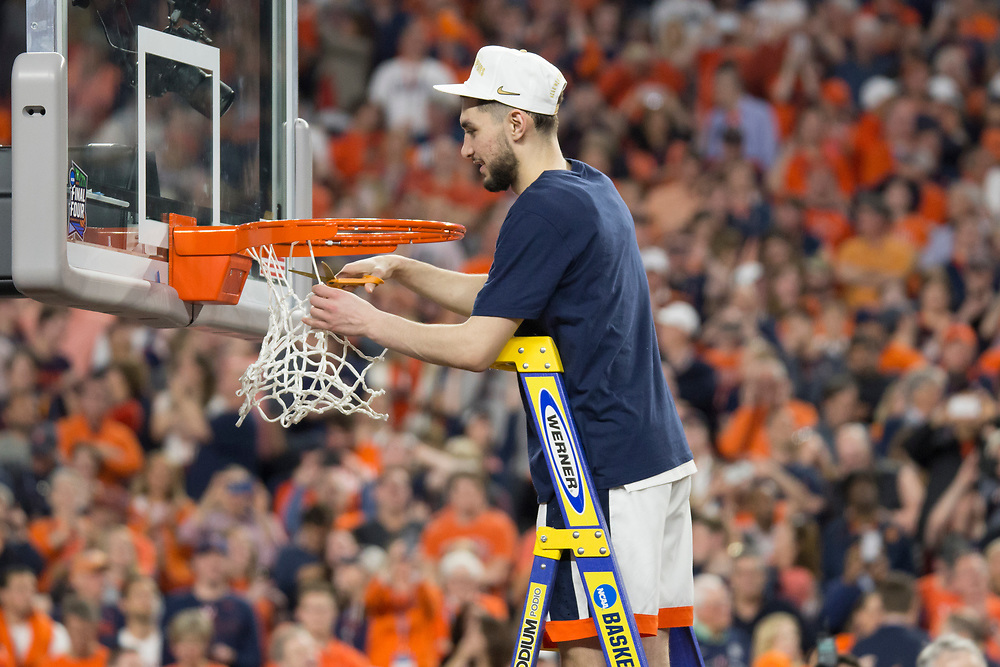 Ty Jerome cutting down the net after Virginia wins the 2019 NCAA Men's Basketball National Championship on April 8, 2019.