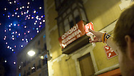 A reveller holds a candle as people sing 'Pobre de Mi' during the end of the San Fermin Festival on July 15, 2014, in Pamplona, Basque Country. Every year, tens of thousands of people pack Pamplona's streets for a drunken kick-off to one os worls's best-known fiesta: the nine-day San Fermin bull-running festival. (Ander Gillenea / Bostok Photo)