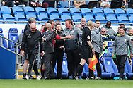 Mark Warburton , the Nottingham Forest manager (l) is pushed away by security as he clashes with Cardiff city back room staff on the touchline during the 1st half. EFL Skybet championship match, Cardiff city v Nottingham Forest at the Cardiff City Stadium in Cardiff, South Wales on Easter Monday 17th April 2017.<br /> pic by Andrew Orchard, Andrew Orchard sports photography.