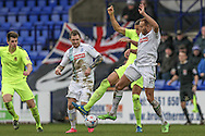 Lois Maynard (Tranmere Rovers) challenges for the ball as James Norwood (Tranmere Rovers) looks on during the Vanarama National League match between Tranmere Rovers and Southport at Prenton Park, Birkenhead, England on 6 February 2016. Photo by Mark P Doherty.