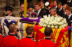 File photo dated 09/04/02 of the Royal family as the coffin of Queen Elizabeth the Queen Mother is prepared to be carried from Westminster Abbey at the end of her funeral service. The Queen mother's funeral was the last royal funeral to be extensively televised in the UK. Issue date: Friday April 16, 2021.