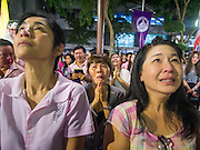13 OCTOBER 2016 - BANGKOK, THAILAND: People at Siriraj Hospital cry and comfort each other Thursday evening after the death of Bhumibol Adulyadej, the King of Thailand, was announced. Thousands of people came to the hospital to pray for the beloved monarch. Bhumibol Adulyadej, the King of Thailand, died at Siriraj Hospital in Bangkok Wednesday, October 13, 2016. Bhumibol Adulyadej, 5 December 1927 – 13 October 2016, was the ninth monarch of Thailand from the Chakri Dynasty and is known as Rama IX. He became King on June 9, 1946 and served as King of Thailand for 70 years, 126 days. He was, at the time of his death, the world's longest-serving head of state and the longest-reigning monarch in Thai history.       PHOTO BY JACK KURTZ