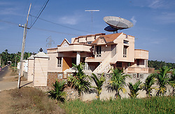 Modern house with satellite dishes installed in Tamil Nadu; India,