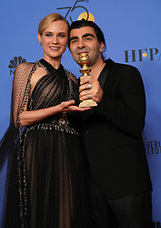 """Actor Diane Kruger (L) and director Fatih Akin pose with the Best Motion Picture - Foreign Language award for 'In The Fade' during NBC's """"75th Annual Golden Globe Awards"""" press room held at the Beverly Hilton Hotel on January 07, 2018 in Beverly Hills, CA, USA (Photo by Carlos Amaya/Sipa USA)"""
