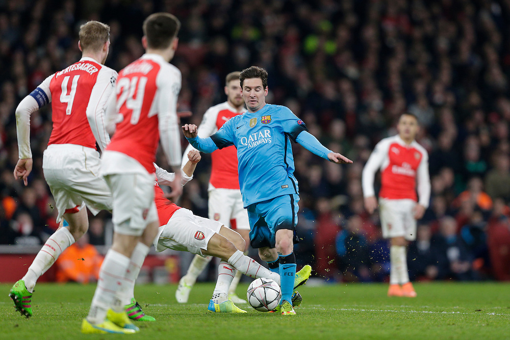 PENALTY - Barcelona's Lionel Messi is fouled by Arsenal's Mathieu Flamini in the box to win a penalty<br /> <br /> Photographer Craig Mercer/CameraSport<br /> <br /> Football - UEFA Champions League Round of 16 - Arsenal v Barcelona - Tuesday 23rd February 2016 - Emirates Stadium - London<br /> <br /> © CameraSport - 43 Linden Ave. Countesthorpe. Leicester. England. LE8 5PG - Tel: +44 (0) 116 277 4147 - admin@camerasport.com - www.camerasport.com