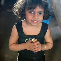 South America, Brazil, Manaus. Young girl in marketplace of Manaus.