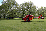 An air ambulance helicopter is seen landed inside Southwark Park in Bermondsey, London to deliver an NHS emergency medical response unit to a road traffic accident after a motorbike and a car collided in Lower Road intersection with Neptun Street near Canada Water Station on Monday, May 4, 2020. (Photo/ Vudi Xhymshiti)