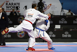 November 10, 2018 - Madrid, Madrid, Spain - German karateka Jonathan Horne seen fighting with Iranian karateka Sajad Ganjzadeh to compete for the Gold Medal  during the Kumite male +84kg final competition of the 24th Karate World Championships at the WiZink centre in Madrid. (Credit Image: © Manu Reino/SOPA Images via ZUMA Wire)