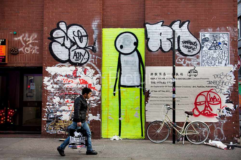 Most Londoners are familiar with the work of Stik for his 'Stik People' are to be found all over East London hanging around on the walls of derelict buildings and sleeping on shop shutters and doorways. Street art in the East End of London is an ever changing visual enigma, as the artworks constantly change, as councils clean some walls or new works go up in place of others. While some consider this vandalism or graffiti, these artworks are very popular among local people and visitors alike, as a sense of poignancy remains in the work, many of which have subtle messages.