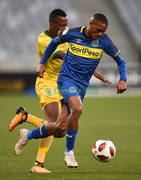 Cape Town-180818 Cape Town City winger Craig Martin challenged by Devine Lunga  of Golden Arrows in a PSL match at Cape Town Stadium .photograph:Phando Jikelo/African News Agency/ANA