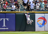 CHICAGO - JULY 02:  Carlos Gomez #14 of the Texas Rangers leaps but cannot catch the ball hit by Melky Cabrera #53 during the game against the Chicago White Sox on July 2, 2017 at Guaranteed Rate Field in Chicago, Illinois.  The White Sox defeated the Rangers 6-5.  (Photo by Ron Vesely) Subject:   Carlos Gomez; Melky Cabrera