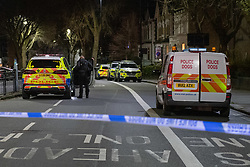 **Incident reported to be connected with the death of Multi-millionaire hotelier Sir Richard Sutton in Dorset**<br /> © Licensed to London News Pictures. 08/04/2021. London, UK. Police vehicles and a dog unit on Chiswick High Road following a incident in which a vehicle was stopped at approximately 22:30hrs on Wednesday 07/04/2021 when police approached the vehicle, officers discovered the lone male occupant had sustained a number of serious self-inflicted injuries. First aid was commenced immediately and the London Ambulance Service were called. The male has been taken to a west London hospital. Photo credit: Peter Manning/LNP