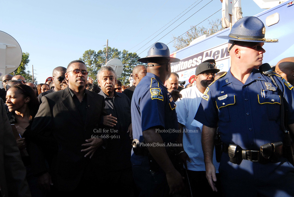"""Sep 20, 2007 - Jena, LA, USA - Louisiana State police walk hand in hand in front of Rev. AL SHARPTON, MICHALE BAISDEN and Michael Bell's mother. The plight of the """"Jena Six"""", a group of black teenagers who were initially charged with attempted murder after beating a white classmate, has provoked one of the biggest civil rights demonstrations in the US in recent years. Protesters converged on the small Louisiana town of Jena to demonstrate against what they said was a double standard of prosecution for blacks and whites. They came in their thousands, protesters from across the United States carrying banners and signs that declared """"Free the Jena six"""" and """"Enough is enough"""". (Credit Image: © Suzi Altman/ZUMA Press"""