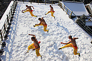 "ZHENGZHOU, CHINA - NOVEMBER 25: (CHINA OUT)<br /> <br /> Monks Exercise In Snow <br /> <br />  Five Buddhist monks exercise in snow while going shirtless in Songshan Mountain scenic resort of Dengfeng County on November 25, 2015 in Zhengzhou, Henan Province of China. They exercise for the performance on ""Shaolin Zen Music Ritual\"" at the end of the year. ©Exclusivepix Media"