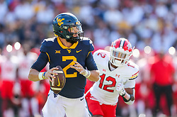 Sep 4, 2021; College Park, Maryland, USA; West Virginia Mountaineers quarterback Jarret Doege (2) drops back for a pass and is chased by Maryland Terrapins defensive back Tarheeb Still (12) during the first quarter at Capital One Field at Maryland Stadium. Mandatory Credit: Ben Queen-USA TODAY Sports