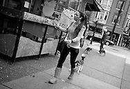 2011 September 25 - Woman and dog, Robson Street, Vancouver, BC, Canada. Copyright Richard Walker
