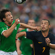 Scott McDonald challenges Sean St. Ledger to the ball during the friendly International between Ireland and Australia at Thomond Park, Limerick, Ireland, Wednesday, August 12, 2009. Photo Tim Clayton.