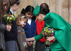 The Duchess of Sussex speaks to school children as she leaves after the Commonwealth Service at Westminster Abbey, London on Commonwealth Day. The service is the Duke and Duchess of Sussex's final official engagement before they quit royal life.