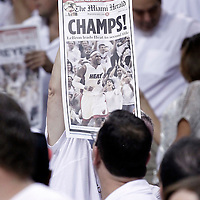 21 June 2012: A fan waives the Miami Herald front page during the fourth quarter of the Miami Heat 121-106 victory over the Oklahoma City Thunder, in Game 5 of the 2012 NBA Finals, at the AmericanAirlinesArena, Miami, Florida, USA. The Miami Heat wins the series 4-1.