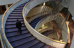 A man climbs the spiral staircase at the European Parliament, in Brussels, Belgium (PHOTO © JOCK FISTICK)