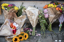 © Licensed to London News Pictures. 20/06/2017. London, UK. Floral tributes and candles are left in Whadcoat Street in Finsbury Park in north London where a van ploughed into a crowd near Finsbury Park Mosque.  One person has been killed and 10 people are injured. Darren Osborne, 47, from Cardiff, continues to be held on suspicion of attempted murder and alleged terror offences.  Photo credit: Peter Macdiarmid/LNP