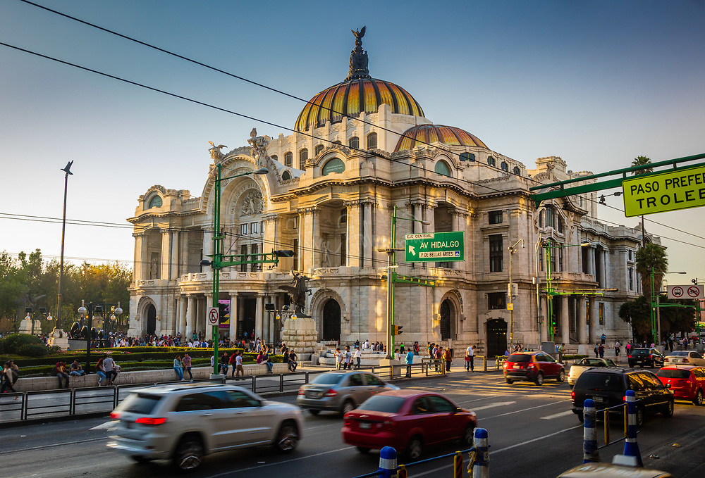 The Palacio de Bellas Artes (Palace of Fine Arts) is one of the most prominent cultural centers in Mexico City. It is located on the west side of the historic center of Mexico City next to the Alameda Central park.<br /> <br /> The first National Theater of Mexico was built in the late 19th century, but it was soon decided to tear this down in favor of a more opulent building in time for Centennial of the Mexican War of Independence in 1910. The initial design and construction was undertaken by Italian architect Adamo Boari in 1904, but complications arising from the soft subsoil and the political problem both before and during the Mexican Revolution, hindered then stopped construction completely by 1913. Construction began again in 1932 under Mexican architect Federico Mariscal and was completed in 1934. The exterior of the building is primarily Neoclassical and Art Nouveau and the interior is primarily Art Deco. The building is best known for its murals by Diego Rivera, Siqueiros and others, as well as the many exhibitions and theatrical performances its hosts, including the Ballet Folklorico de Mexico.