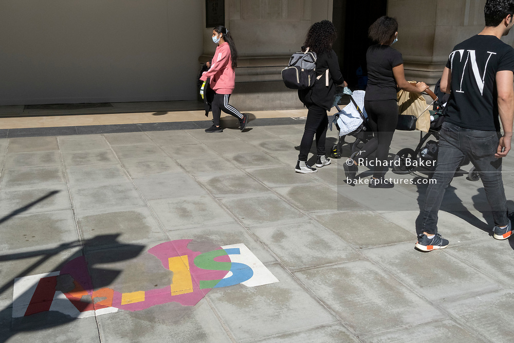 A peeling and faded stencil for the NHS (National Health Service) is still on the pavement outside Selfridges, a year after the first lockdown, during the third lockdown of the Coronavirus pandemic, on 29th March 2021, in London, England.