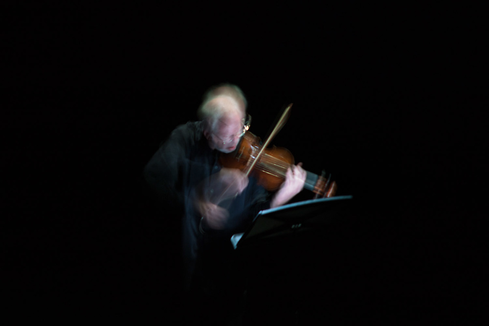"""NEW YORK, NY - OCTOBER 31, 2017: Gidon Kremer during a performance of Mieczyslaw Weinberg's """"24 Preludes,"""" part of the night's program """"Preludes to a Lost Time (Imaginary Dialogues)"""" at the Jerome Robbins Theater at the Baryshnikov Arts Center in Manhattan. CREDIT: Emon Hassan for The New York Times"""