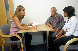 Council housing officer and new tenants, signing contract, London UK, handing over keys, London UK, with contract, London UK