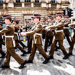 1st Battalion Scots Guards parade down the Royal Mile
