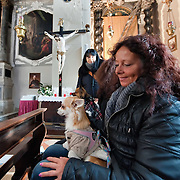 VENICE, ITALY - JANUARY 15:  Worshippers with their dogs attend a special service with a blessiing of  pets and animals held by Don Filippo Chiafoni Chaplain of the Church of S Francesco da Paola on January 15, 2012 in Venice, Italy. The blessing of animals and pets is a very ancient tradition dating back from San Francis of Assisi.