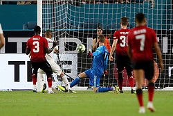 July 31, 2018 - Miami Gardens, FL, U.S. - MIAMI GARDENS, FL - JULY 31: Real Madrid forward Karim Benzema (9) scores a goal against Manchester United goalkeeper David De Gea (1) during the first half of an International Champions Cup match at Hard Rock Stadium in Miami Gardens, Florida. Manchester United defeated Real Madrid 2-1. (Photo by Douglas Jones/Icon Sportswire) (Credit Image: © Douglas Jones/Icon SMI via ZUMA Press)
